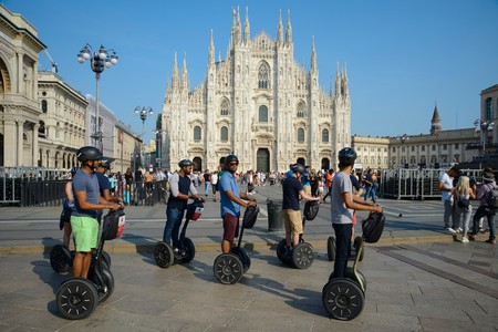 Italy, Lombardy, Milan, Piazza Duomo Square, Tourists on Guided Segway Tour