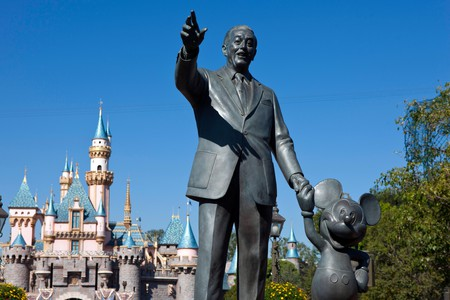 Detailed view of the Partners statue of Walt Disney and Mickey Mouse with Sleeping Beauty Castle in the background, Disneyland,