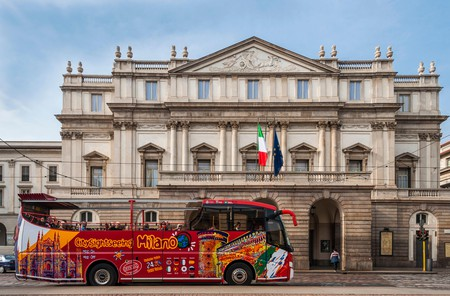 Sightseeing bus in front of La Scala, Milan, Lombardy, Italy