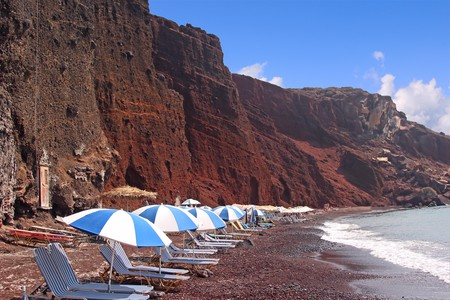 The backdrop of red volcanic rocks are a big draw to Santorini's Red Beach