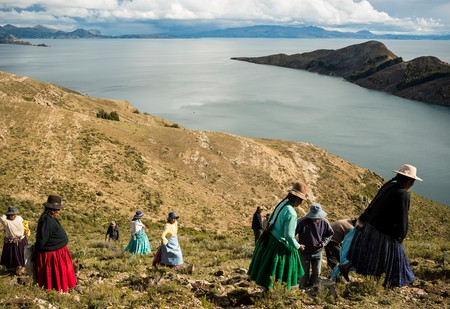 Local Bolivians work on repairing the Inca Trail on Isla del Sol