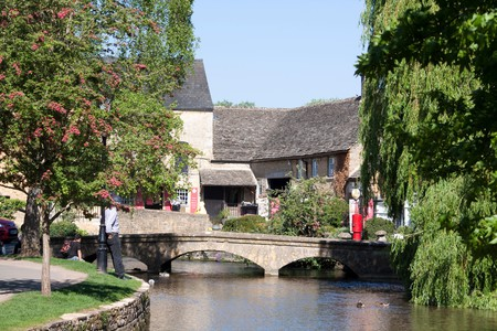 Bourton-on-the-Water has earned its nickname as the Venice of the Cotswolds