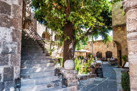 Enjoy a drink al fresco in the courtyard at Sissitio, in the Old Town of Rhodes