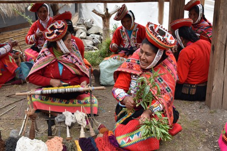 The women of Huilloc make blankets, purses, ponchos, headbands, scarfs, table runners and key chains, all woven with intricate designs |