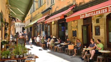 Enjoy a streetside drink at Les Distilleries Idéales