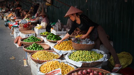 Head to a market in Hanoi to sample local food and get a sense of the city