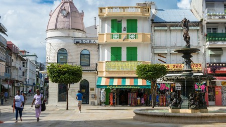The Market Square in Pointe-à-Pitre is characterized by colorful shop awnings and 19th-century buildings
