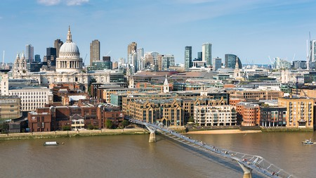 A view over the City of London, with St Paul's Cathedral and the Millennium Bridge