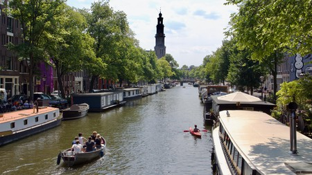 Enjoy a cruise through the canals of Amsterdam, beer in hand