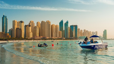 Soar above the luxury buildings of Jumeirah Beach Residence with a parasailing experience in Dubai |