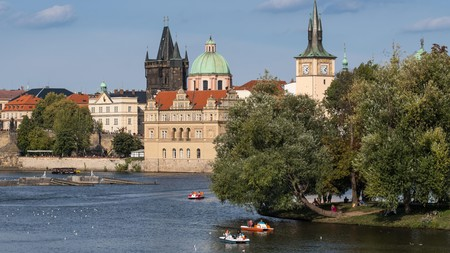 The Vltava River in Prague, with the Charles Bridge gatehouse in the background