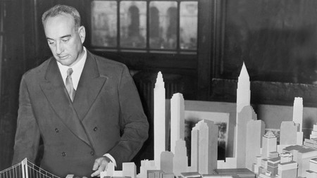 New York City Park Commissioner Robert Moses (1888-1981) with a model of the proposed Battery Bridge in 1939