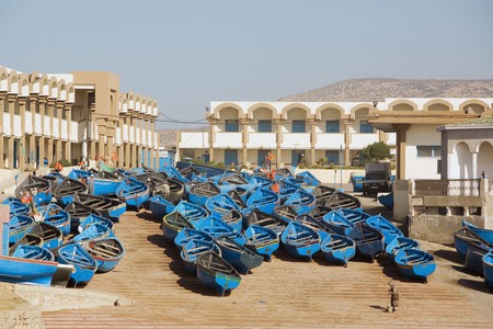 Fishing boats line up on the shore in Imsouane