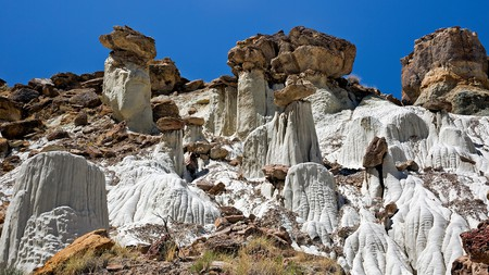 The beautiful Wahweap Hoodoos, white with red cap rocks, form part of the Grand Staircase-Escalante National Monument