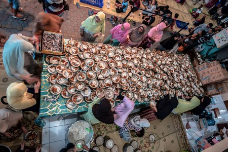 Muslims break their daily fast during Ramadan after sunset with iftar