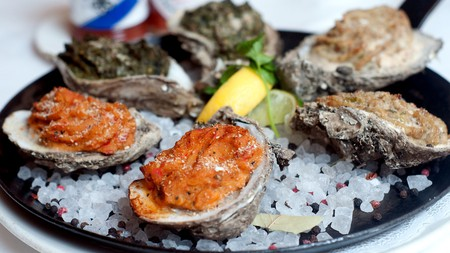 Baked oysters au gratin are a favourite in the New Orleans French Quarter