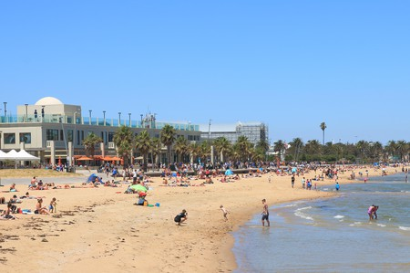 People visit St Kilda beach in Melbourne, Australia.