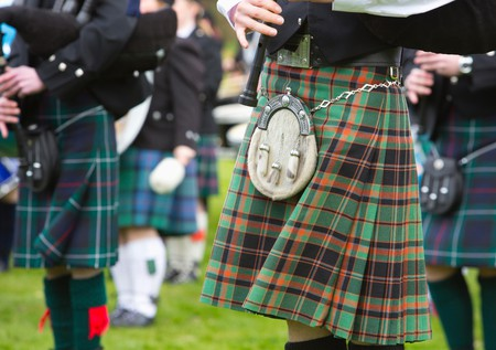 A detail of the kilts of a pipe band, Scotland.