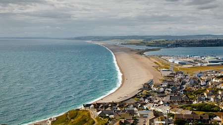 Take a trip to one of the many British beaches, such as Chesil beach in Dorset, that often get overlooked but are well worth a visit