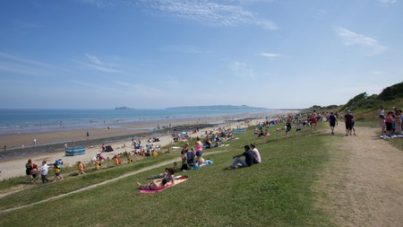 People relaxing at the seaside at Portmarnock beach, Dublin, Ireland