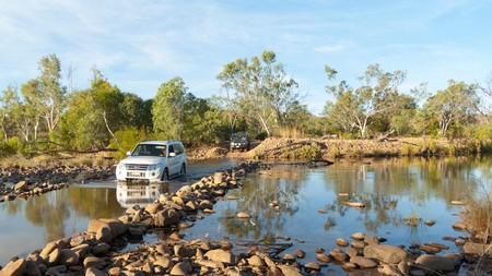 Car crossing a river along the Gibb River Road, Kimberley, Outback, Western Australia, WA, Australia