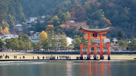 Miyajima is known for its striking red torii gate, which appears to float in the sea