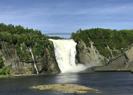 Experience the sheer power of mother nature on a day trip to Montmorency Falls | Daniel Slim / AFP via Getty Images