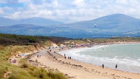 Visitors to Newborough Beach are even treated to spectacular views of Snowdonia National Park