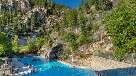 Soaking in an outdoor pool at the Radium hot springs makes a great excursion from Banff