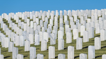 Gravestones line the green hills of the historic Santa Fe National Cemetery in New Mexico