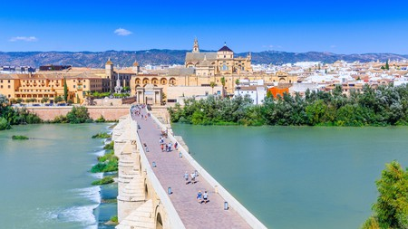 The Roman Bridge in Córdoba spans the River Guadalquivir and dates back to the first century