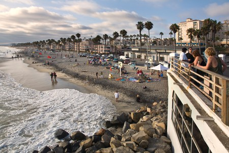 Beach-goers enjoying the outdoors at the Oceanside Pier