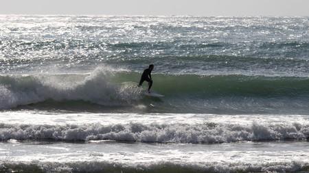Man surfing a wave in Mediterranean sea