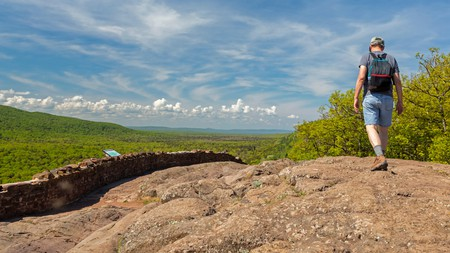 A hiker on the escarpment above Lake of the Clouds in Porcupine Mountains Wilderness State Park