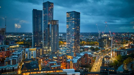 The striking Deansgate skyline in Manchester gleaming at night