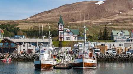 The picturesque village of Húsavík, in Iceland, is a good choice for a holliday this summer