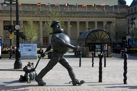 Statue of Desperate Dan from the Dandy Comic with the Caird Hall in the background, High Street, Dundee