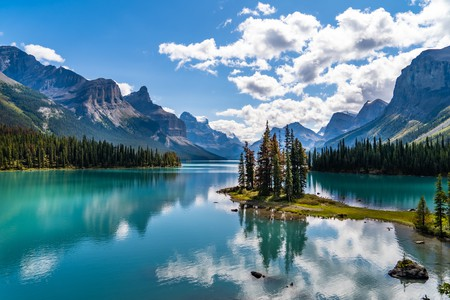Maligne Lake is home to three glaciers, various summertime boat cruises, and access to the Skyline Trail and Spirit Island