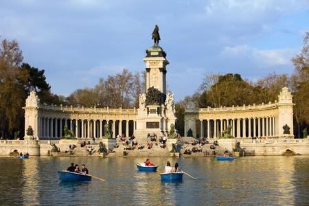 Monument to King Alfonso XII and lake in Buen Retiro Park (Spanish: El Parque de Retiro) in Madrid, Spain.