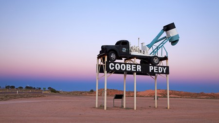 "An old mining truck welcomes you to the town of Coober Pedy, which is known as the ""opal mining capital of the world"""