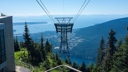 Enjoy the view of Coal Harbour by cable car from the top of Grouse Mountain