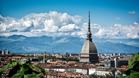 Sunny days mean panoramic views across Turin, Italy, featuring Mole Antonelliana and the Alps