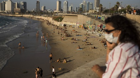 In Tel Aviv, masks are mandatory everywhere in public, even on the beach, and the number of people allowed inside restaurants and bars is restricted