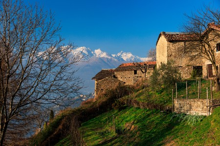 Village of Mandonico, over Dorio, with lake Como mountains on the background, Dorio, Province of Lecco, Lombardy, Italy