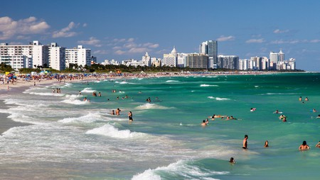 Miami Beach filled with swimmers and surfers enjoying the waves
