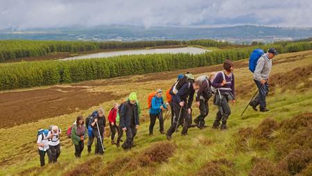 A rambling club enjoys a walk in the Pentland Hills near Bonaly Country Park