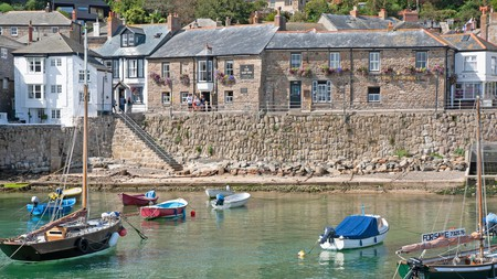 Enjoy views of peaceful bobbing boats in the harbour from your room at The Ship Inn, in Mousehole near Penzance