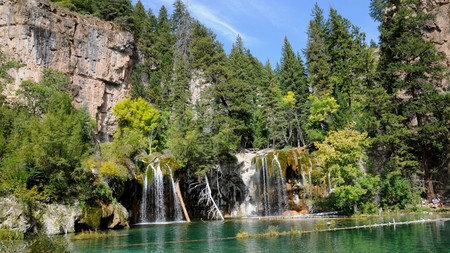 Must-visit Colorado waterfalls include Hanging Lake near Glenwood Springs