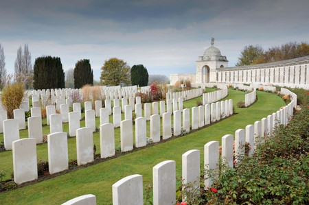 See the graves of World War I soldiers at Tyne Cot Cemetery just outside Ypres