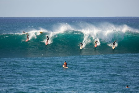 Catching a wave at Waimea Bay, on Oahu
